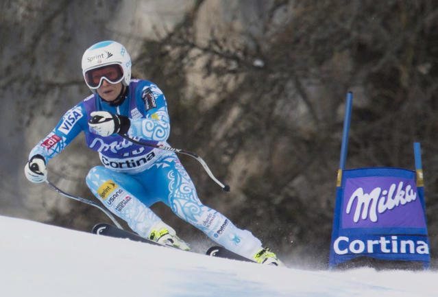 Julia Mancuso of the United States speeds down the course during an alpine ski, women's World Cup super g, in Cortina D'Ampezzo, Italy, Sunday, Jan. 26, 2014. Mancuso placed 16th. (AP Photo/Domenico Stinellis)