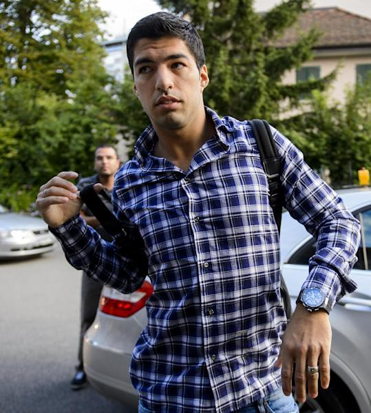 Barcelona forward Luis Suarez, currently serving a four-month suspension, arrives for his appeal before the Court of Arbitration for Sport in Lausanne on August 8, 2014 (AFP Photo/Fabrice Coffrini)