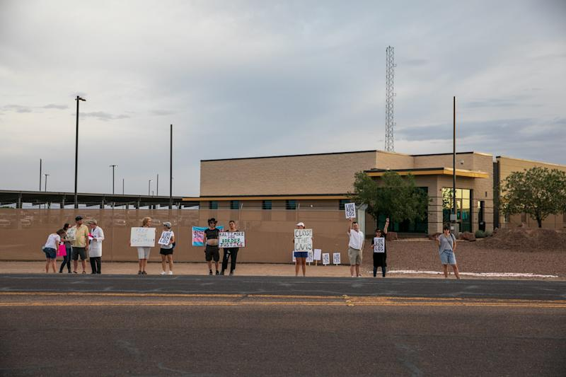 Protesters from around the country wave signs in front of the Clint, Texas, facility on July 4, 2019.