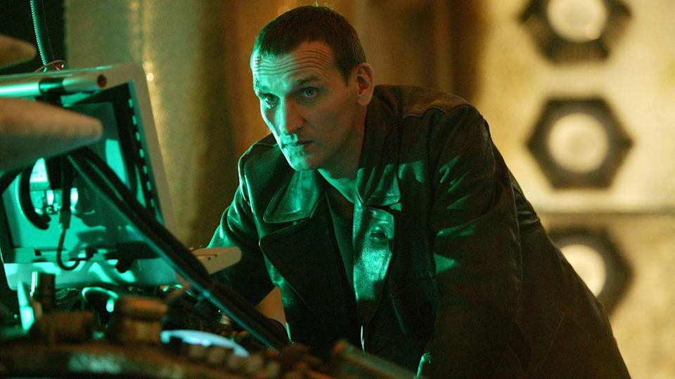Ninth Doctor Stands at TARDIS console