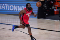 Houston Rockets' James Harden (13) brings the ball up the court against the Los Angeles Lakers during the second half of an NBA conference semifinal playoff basketball game Thursday, Sept. 10, 2020, in Lake Buena Vista, Fla. (AP Photo/Mark J. Terrill)