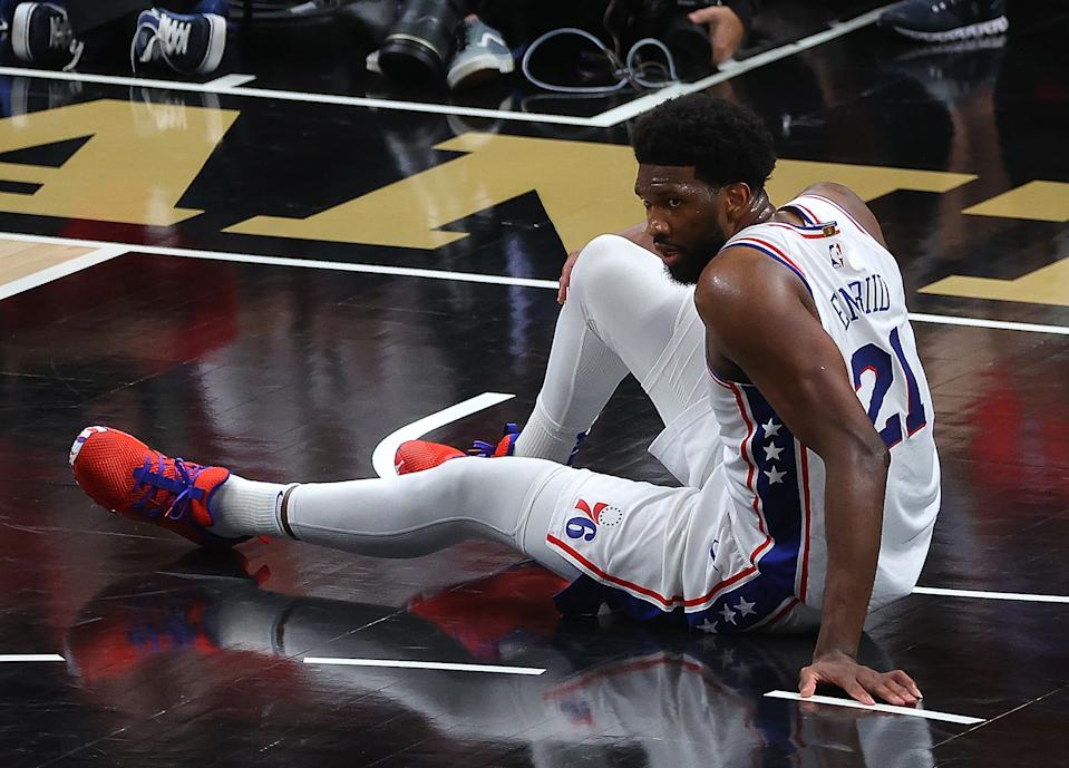 Philadelphia 76ers center Joel Embiid struggled to finish Game 4. (Kevin C. Cox/Getty Images)