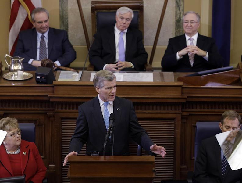 Virginia Gov. Bob McDonnell, at podium, gestures as he delivers his State of the Commonwealth address before a joint session of the 2014 General Assembly at the Capitol in Richmond, Va., Wednesday, Jan. 8, 2014. Lt. Gov. Bill Bolling, top left, House speaker William Howell, R-Stafford, top center, and State Sen. Walter Stosch, R-Henrico, top right, listen. (AP Photo/Steve Helber)