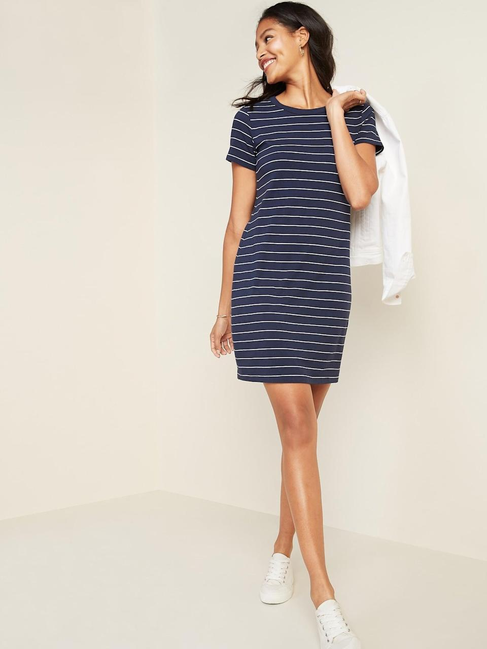 """<p>This <a href=""""https://www.popsugar.com/buy/Old-Navy-Fitted-Striped-Crew-Neck-Tee-Dress-586322?p_name=Old%20Navy%20Fitted%20Striped%20Crew-Neck%20Tee%20Dress&retailer=oldnavy.gap.com&pid=586322&price=15&evar1=fab%3Aus&evar9=47589362&evar98=https%3A%2F%2Fwww.popsugar.com%2Fphoto-gallery%2F47589362%2Fimage%2F47589369%2FOld-Navy-Fitted-Striped-Crew-Neck-Tee-Dress&list1=shopping%2Cold%20navy%2Cdresses%2Csummer%2Cproducts%20under%20%2450&prop13=api&pdata=1"""" class=""""link rapid-noclick-resp"""" rel=""""nofollow noopener"""" target=""""_blank"""" data-ylk=""""slk:Old Navy Fitted Striped Crew-Neck Tee Dress"""">Old Navy Fitted Striped Crew-Neck Tee Dress</a> ($15, originally $30) will be a summer staple.</p>"""