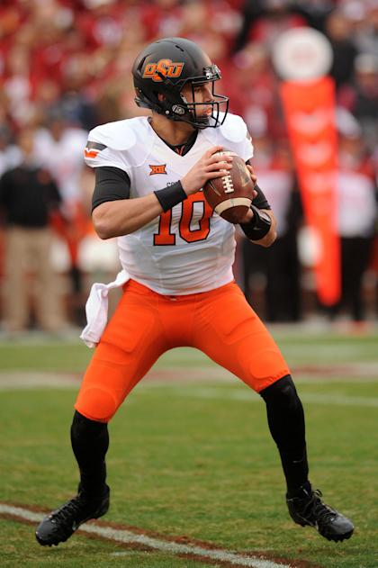 Dec 6, 2014; Norman, OK, USA; Oklahoma State Cowboys quarterback Mason Rudolph (10) looks to pass the ball against the Oklahoma Sooners during the first quarter at Gaylord Family - Oklahoma Memorial Stadium. (Mark D. Smith-USA TODAY Sports)