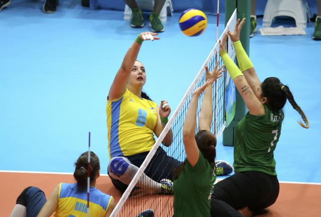 2016 Rio Paralympics - Sitting Volleyball - Women's Bronze Match - Riocentro Pavilion 6 - Rio de Janeiro, Brazil, 17/09/2016. Oleksandra Podliesna (UKR) of Ukraine and Nathalie de Lima Silva (BRA) of Brazil in action. REUTERS/Pilar Olivares FOR EDITORIAL USE ONLY. NOT FOR SALE FOR MARKETING OR ADVERTISING CAMPAIGNS.