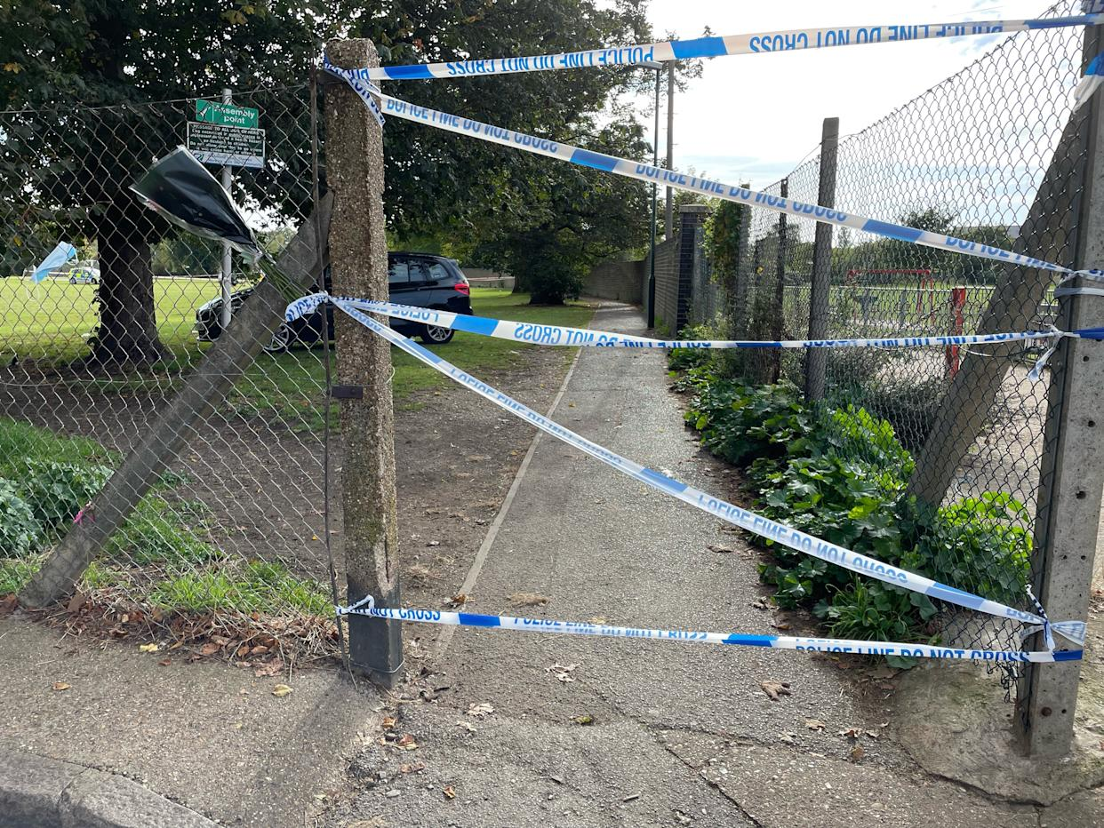 Police tape blocks the entrance to a playing field in Craneford Way, Twickenham, south-west London, where an 18-year-old was stabbed on Tuesday afternoon.