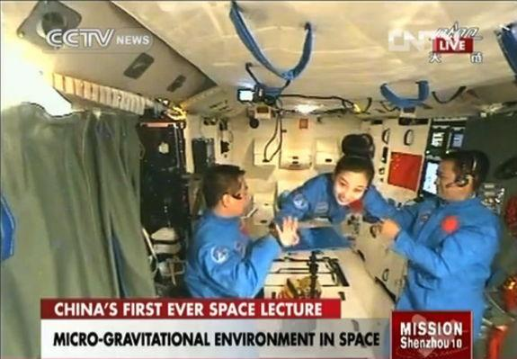 A video screengrab shows the Chinese astronauts aboard space station Tiangong-1 prepare for the space lecture to be delivered by Wang Yaping on June 20, 2013.