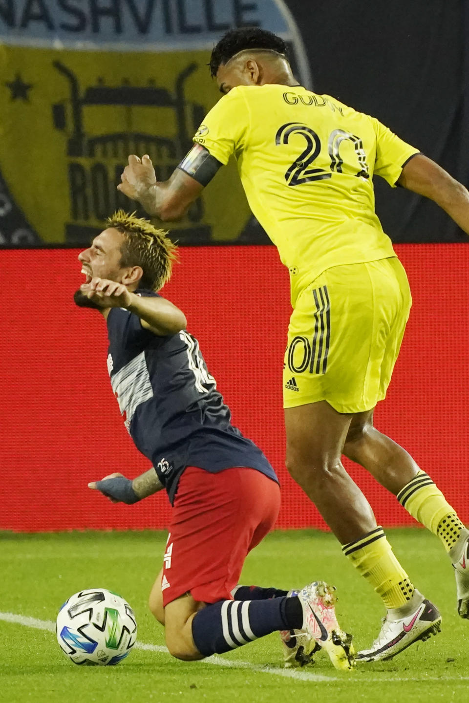 New England Revolution forward Diego Fagundez, left, and Nashville SC midfielder Anibal Godoy (20) collide during the first half of an MLS soccer match Friday, Oct. 23, 2020, in Nashville, Tenn. (AP Photo/Mark Humphrey)