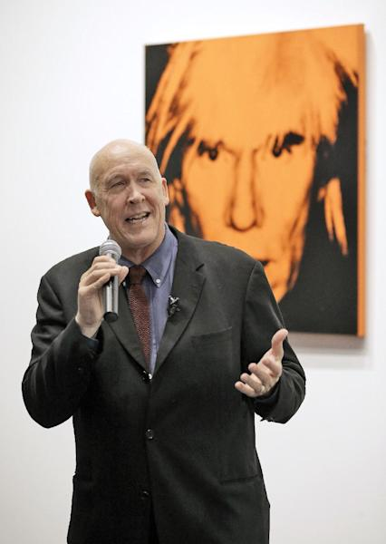 "The Dali Museum Executive Director Dr. Hank Hine, gestures in front of a 1986 self portrait of artist Andy Warhol during a media tour Wednesday, Jan. 15, 2014, at The Dali Museum in St. Petersburg, Fla. ""Warhol: Art. Fame. Mortality."" opens to the public on Jan. 18 and runs until April 27, 2014. (AP Photo/Chris O'Meara)"