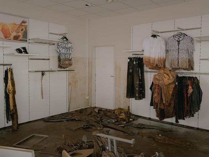 """A damaged clothing store in the aftermath of the floods in the city center of Euskirchen, Germany, July 16, 2021.<span class=""""copyright"""">DOCKS Collective</span>"""
