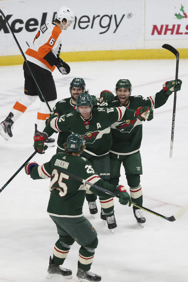 Minnesota Wild's Eric Staal looks to teammate Jonas Brodin in celebration after Staal scored a goal against the Philadelphia Flyers in the first period of an NHL hockey game Saturday Dec. 14, 2019, in St. Paul, Minn. (AP Photo/Stacy Bengs)