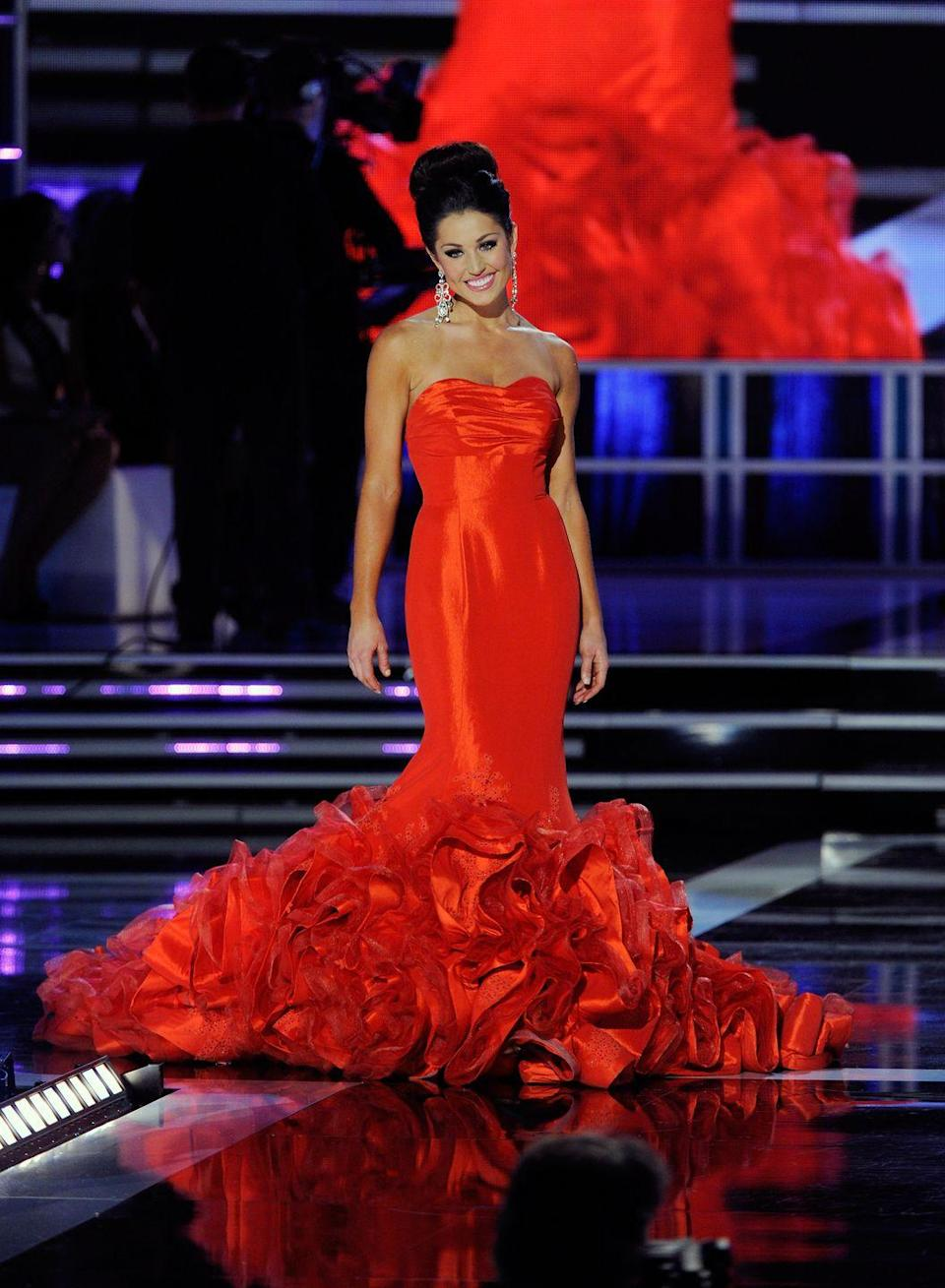 <p>Megan Ervin's strapless gown's ruffled train went on for days. With the bright red color and intricate detailing, her memorable gown resembled the prettiest of roses.</p>
