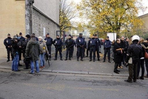 <p>Policemen stand guard in front of the Bordeaux courthouse where former French president Nicolas Sarkozy appeared before an examining magistrate to respond to charges that his 2007 electoral campaign was financed with funds secured illegally from France's richest woman. He denied the allegation, a report said.</p>