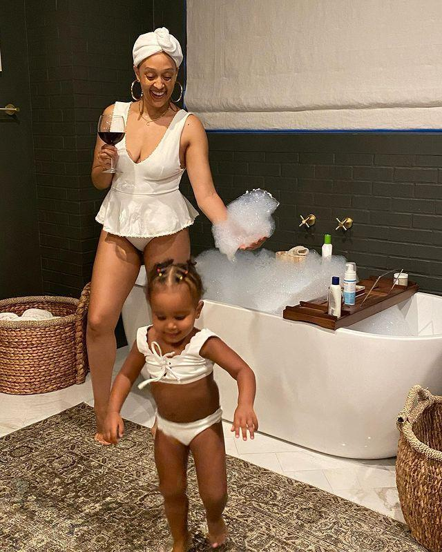 <p>Tia Mowry and her daughter Cairo enjoyed some self care in matching white Marysia suits in May 2020.</p>