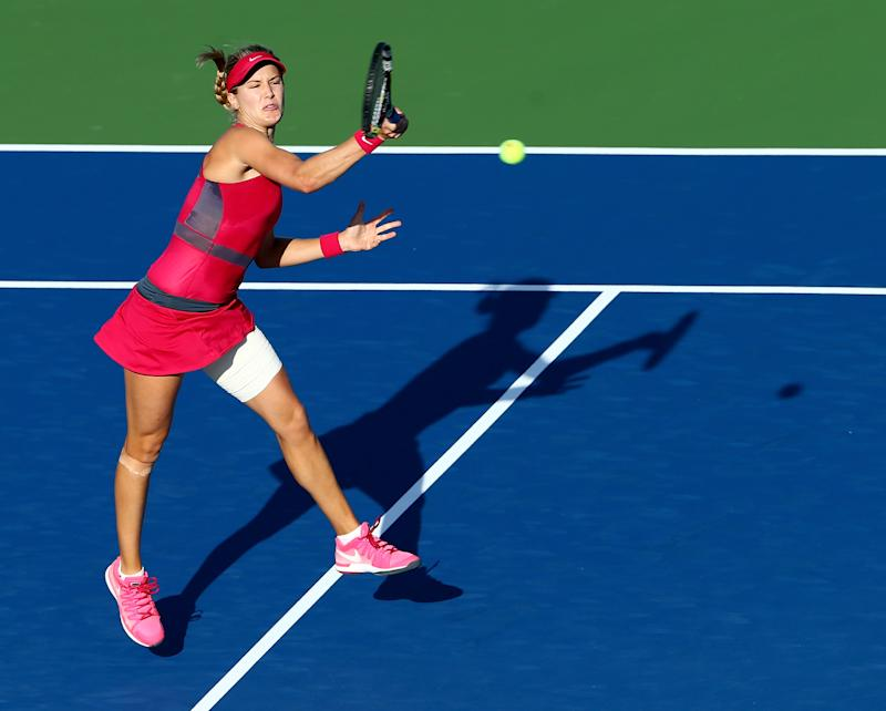 Eugenie Bouchard returns a shot to Bojana Jovanovski during their Connecticut Open match at Yale on August 18, 2014