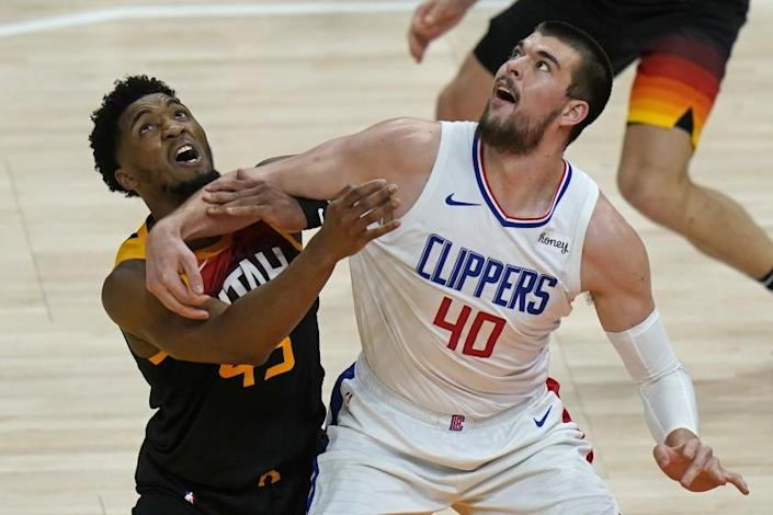 Clippers center Ivica Zubac, right, and Utah Jazz guard Donovan Mitchell battle for position June 10, 2021.