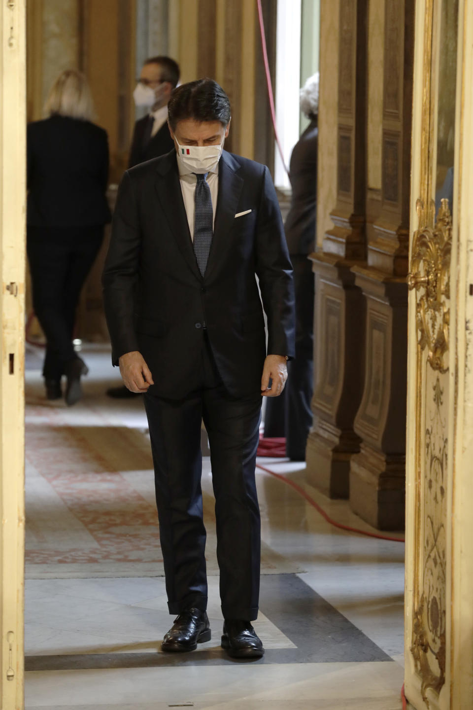 Italian outgoing Premier Giuseppe Conte arrives to hand over the cabinet minister bell to new Premier Mario Draghi, during the handover ceremony at Chigi Palace Premier's office, in Rome, Saturday, Feb. 13, 2021. (AP Photo/Andrew Medichini)