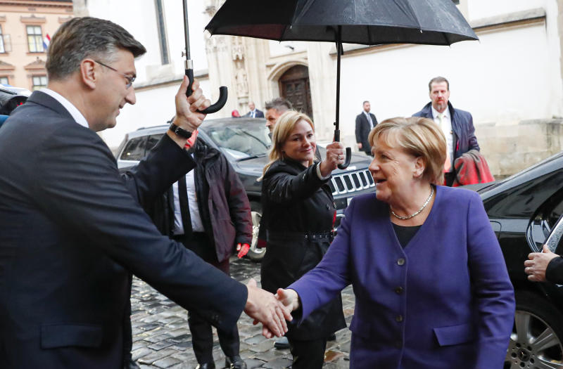 German Chancellor Angela Merkel, right, shakes hands with Croatia's prime minister Andrej Plenkovic in Zagreb, Croatia, Wednesday, Nov. 20, 2019. will attend the European Peoples Party (EPP) congress in the Croatian capital. (AP Photo/Darko Bandic)