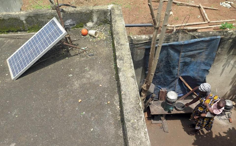 "A solar-powered cooker, called ""Mivo"", which means ""Take it easy"" in the local Fon language -- has been marketed by a charity called Autre Vie in Porto-Novo (AFP Photo/)"