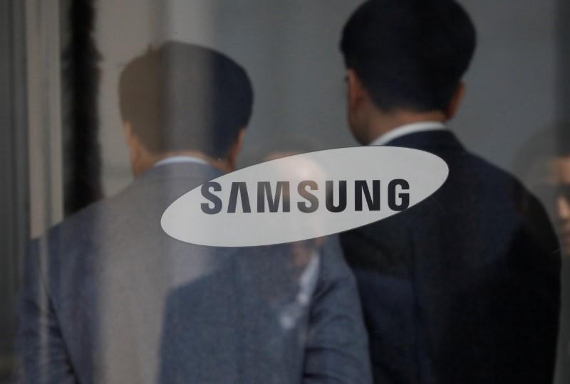 Employees walks in the building of Samsung Electronics in Seoul