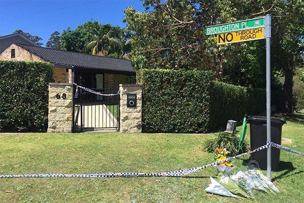 Family, friends and neighbours leave flowers outside the family home. Photo: AAP