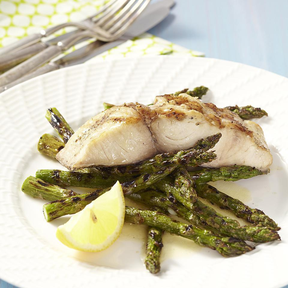 "<p>In this quick grilled fish recipe, we grill firm mahi-mahi and fresh spring asparagus alongside one another, then drizzle them with a bit of tart lemon butter. We like mahi-mahi in this recipe, but any firm fish fillet can be used in its place. <a href=""http://www.eatingwell.com/recipe/250674/grilled-mahi-mahi-asparagus-with-lemon-butter/"" rel=""nofollow noopener"" target=""_blank"" data-ylk=""slk:View recipe"" class=""link rapid-noclick-resp""> View recipe </a></p>"