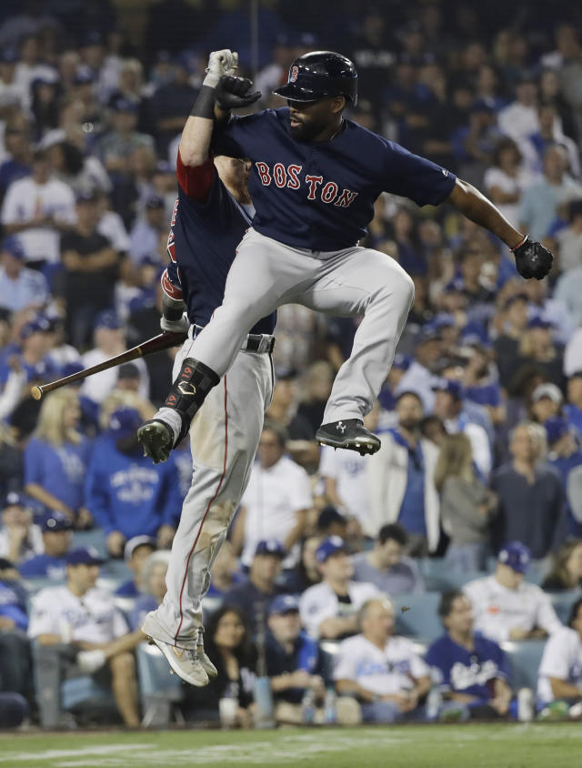 Boston Red Sox's Jackie Bradley Jr., right, celebrates with Christian Vazquez after hitting a solo home run during the eighth inning in Game 3 of the World Series baseball game on Friday, Oct. 26, 2018, in Los Angeles. (AP Photo/David J. Phillip)