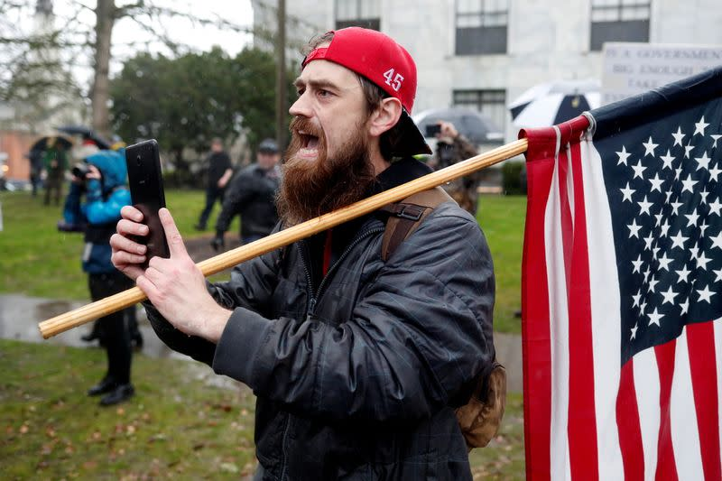 A supporter of U.S. President Donald Trump confronts police at a rally in support of Trump at the Oregon State Capitol in Salem