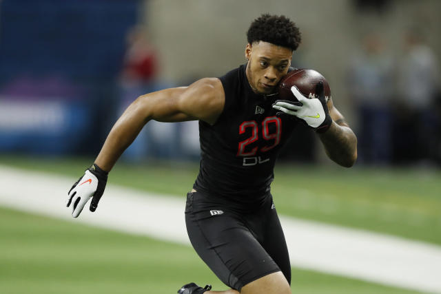 In this Feb. 29, 2020, photo, Penn State defensive lineman Yetur Gross-Matos runs a drill at the NFL football scouting combine in Indianapolis. Gross-Matos would have liked to be in Las Vegas on Thursday, April 23, 2020, with other NFL draft prospects, but the Penn State defensive lineman is just as comfortable watching it at home. (AP Photo/Charlie Neibergall)