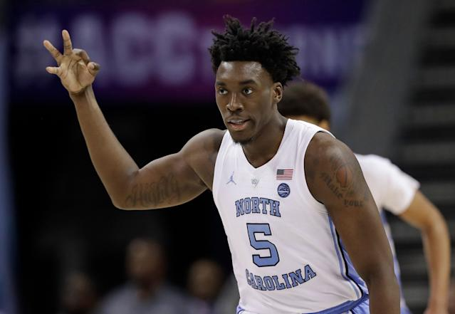 North Carolina's Nassir Little (5) reacts after making a basket against Louisville during the second half of an NCAA college basketball game in the Atlantic Coast Conference tournament in Charlotte, N.C., Thursday, March 14, 2019. (AP Photo/Chuck Burton)