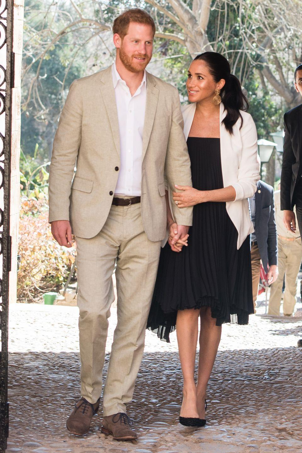 <p>Harry and Meghan walked hand in hand as they visited the Andalusian Gardens in Morocco. </p>