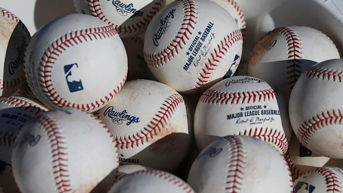 Representative: In this 14 February 2020, file photo, baseballs sit in a bucket after they were used for fielding practice during spring training baseball workouts for pitchers and catchers at Cleveland Indians camp in Avondale, Arizona (AP)