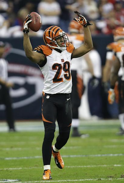Cincinnati Bengals cornerback Leon Hall celebrates after intercepting the ball for a touchdown against the Houston Texans during the second quarter of an NFL wild card playoff football game Saturday, Jan. 5, 2013, in Houston. (AP Photo/Eric Gay)