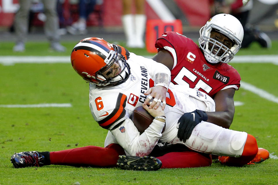 Cleveland Browns quarterback Baker Mayfield (6) is sacked by Arizona Cardinals linebacker Chandler Jones during the first half of an NFL football game, Sunday, Dec. 15, 2019, in Glendale, Ariz. (AP Photo/Rick Scuteri)