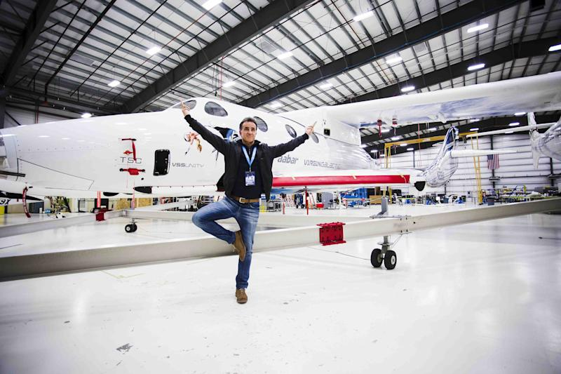 David Perez, who is excited about being the first Moroccan-decent Jew in space, strikes a pose in front of the Virgin Galactic spaceship that will take him 50 miles high.