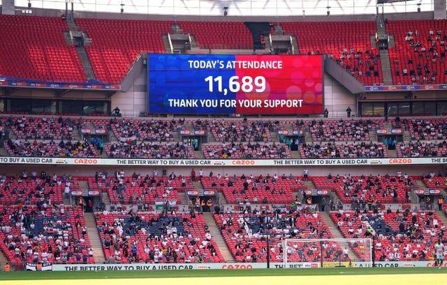 A big screen displays the match attendance of 11,689 thanking fans for their support during the Sky Bet Championship play-off final at Wembley