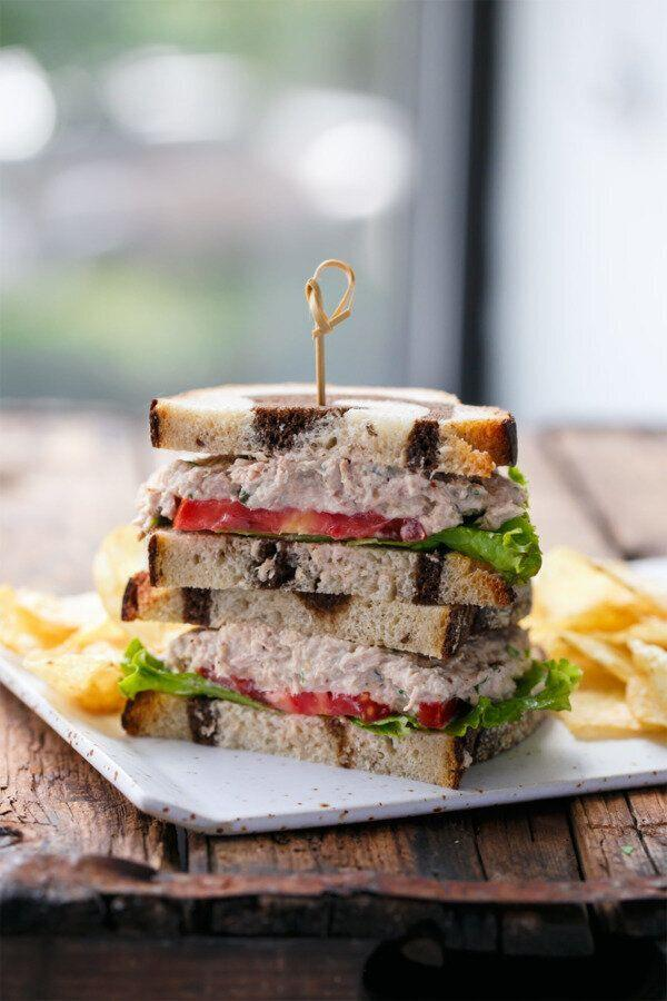 """<strong><a href=""""https://www.loveandoliveoil.com/2017/06/best-tuna-salad-sandwich.html"""" target=""""_blank"""" rel=""""noopener noreferrer"""">Get Taylor's Best Tuna Salad Sandwich recipe from Love and Olive Oil</a></strong>"""