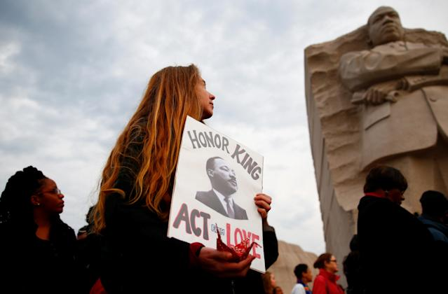 <p>People attend a silent march and rally on the National Mall to mark the 50th anniversary of the assassination of civil rights leader Rev. Martin Luther King Jr. in Washington, April 4, 2018. (Photo: Eric Thayer/Reuters) </p>