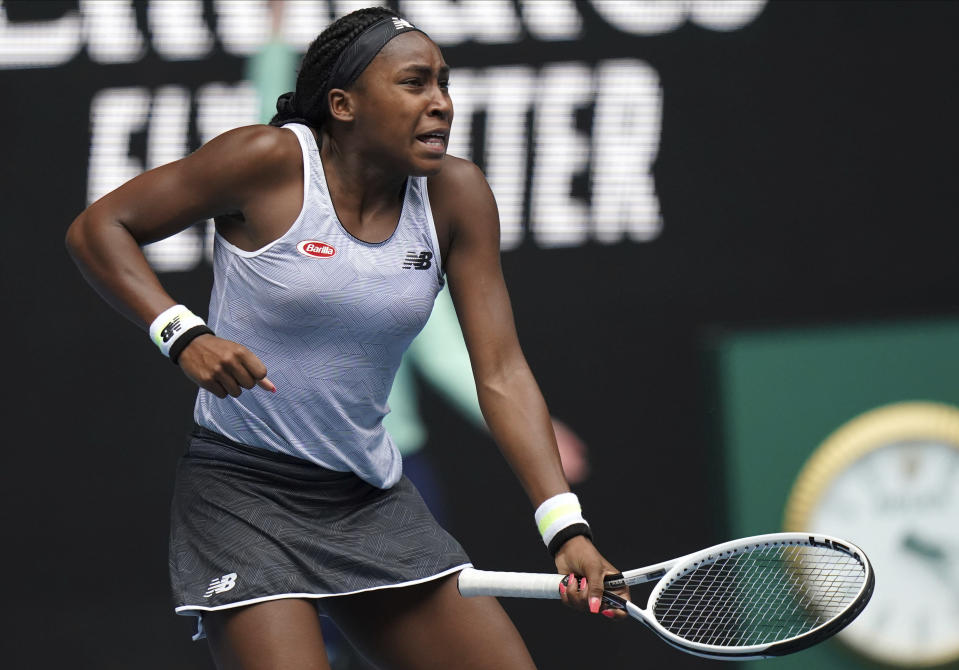 "Cori ""Coco"" Gauff of the U.S. reacts after winning a point against Romania's Sorana Cirstea during their second round singles match at the Australian Open tennis championship in Melbourne, Australia, Wednesday, Jan. 22, 2020. (AP Photo/Lee Jin-man)"