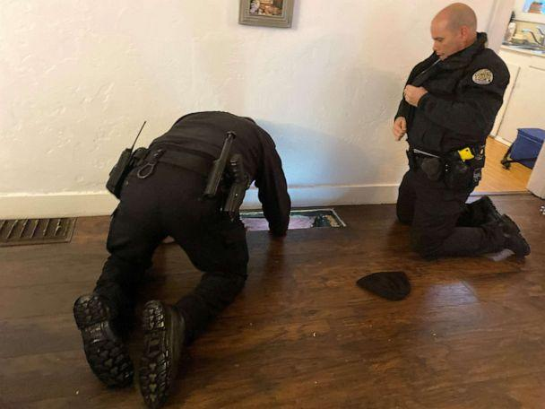 PHOTO: Police officers in Oregon look in a heating vent that a 10-month-old baby fell through. (Courtesy Saydie Reedy)