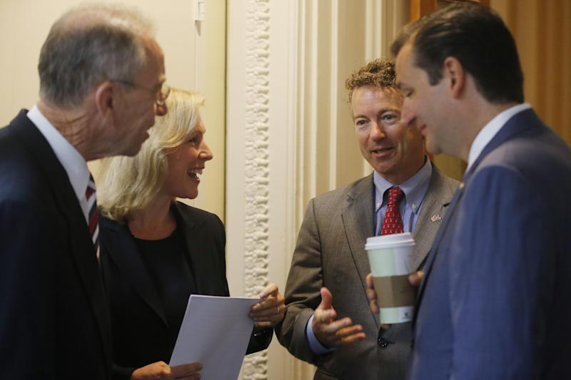 Sen. Chuck Grassley, R-Iowa, left, Sen. Kirsten Gillibrand, D-N.Y., second left, Sen. Rand Paul, R-Ky., second right, and Sen. Ted Cruz, R-Texas, huddle before a news conference about a bill regarding military sexual assault cases on Capitol Hill in Washington, Tuesday, July 16, 2013. (AP Photo/Charles Dharapak)
