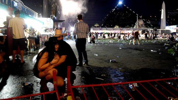 PHOTO: People take cover at the Route 91 Harvest country music festival after  gun fire was heard, Oct. 1, 2017 in Las Vegas, Nevada.   (David Becker/Getty Images)
