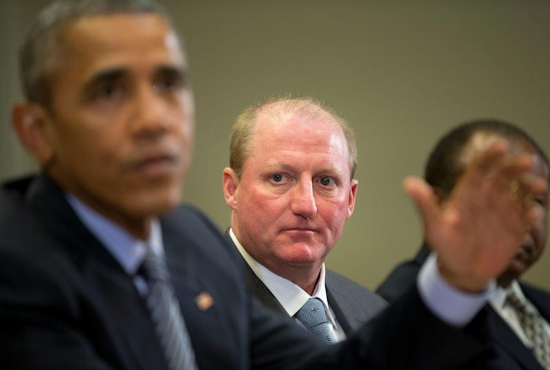 Berkshire Hathaway Energy's department head, Gregory Abel, listens as President Barack Obama does Speaking at a meeting with White House leaders in Washington, Monday, October 19, 2015. [AP Photo / Pablo Martinez Monsivais]