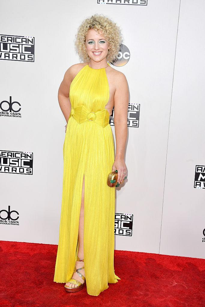 <p>The country singer lit up the red carpet in a bright yellow dress. <em>(Photo: Getty Images)</em> </p>