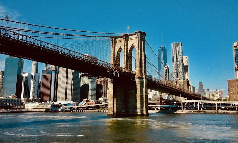 """<p>First opened in 1883, the stunning Brooklyn Bridge now sees <a href=""""http://www.nycgo.com/articles/guide-to-the-brooklyn-bridge"""" class=""""link rapid-noclick-resp"""" rel=""""nofollow noopener"""" target=""""_blank"""" data-ylk=""""slk:around 100,000 cars on a daily basis"""">around 100,000 cars on a daily basis</a>. It makes for a stunning NYC memory, so Peter and Trevor enthusiastically use it as a backdrop for yet another picture. </p>"""