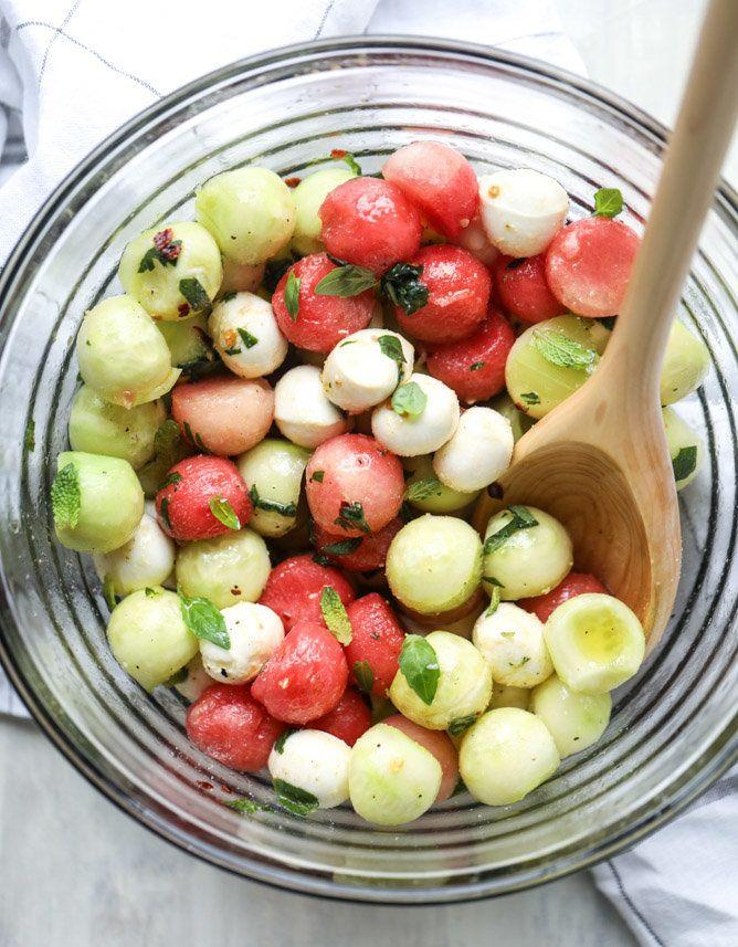 """<strong>Get the <a href=""""http://www.howsweeteats.com/2017/05/marinated-mozzarella-melon-salad/"""" rel=""""nofollow noopener"""" target=""""_blank"""" data-ylk=""""slk:Marinated Mozzarella Melon Salad recipe"""" class=""""link rapid-noclick-resp"""">Marinated Mozzarella Melon Salad recipe</a>&nbsp;from How Sweet It Is</strong>"""