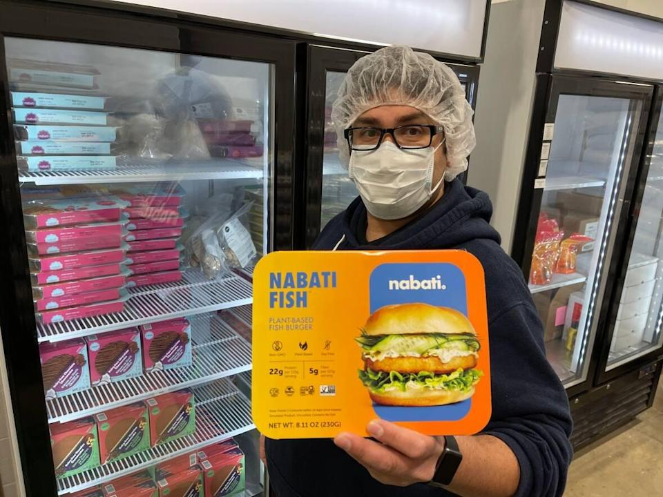 Ahmad Yehya, co-founder and CEO of Nabati Food displays one if the company's plant-based food products in its warehouse. (Travis McEwan/CBC - image credit)