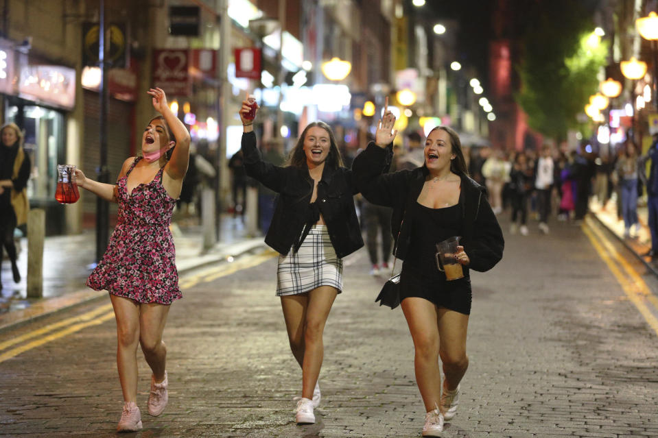 People are out socializing in Liverpool city centre, ahead of the 10 p.m. curfew that pubs and restaurants are subject to in order to combat the rise in coronavirus cases in England, Saturday, Oct. 10, 2020. Prime Minister Boris Johnson is on Monday expected to back a new three-tier local lockdown system, which could see pubs and restaurants in coronavirus hotspots in England being temporarily closed. (Peter Byrne/PA via AP)