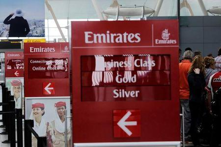 Signs point to the Emirates Airlines check in desks at JFK International Airport in New York